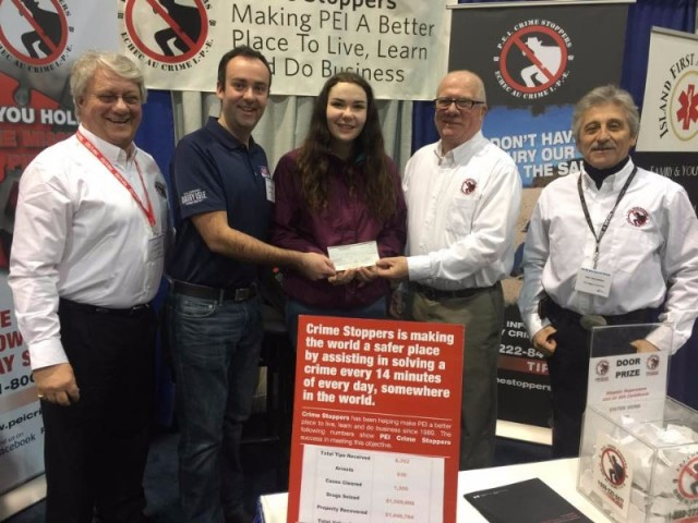 Winner of PEI Crimestoppers AntiBullying Logo Contest receives her prize.. Left to right: President Don Reid, ADL Rep Jamie MacPhail, Samantha MacLean, Coordinator Phil Pitts & Director Ron McConnell