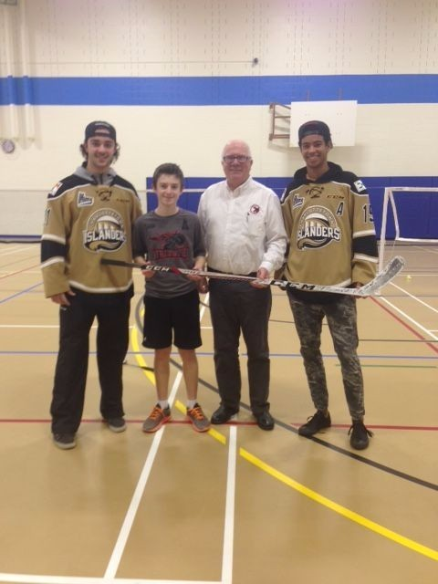 Congratulations to Andrew McKenna on his second place finish in the 2018 Pink Shirt Design contest.   Andrew, a Grade 7 student at Ecole Francois Buote,  is seen here receiving his Charlottetown Islanders team autographed stick from Islander players Pascal Aquin and P.O. Joseph and Crime Stoppers Coordinator Phil Pitts