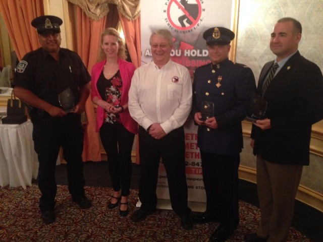 L to R: Cst. Tim Keizer, Cst. Kim Dudley, Crime Stoppers President Don Reid, Cst. Jonathan Kennedy, Cst. Stepehn Duggan