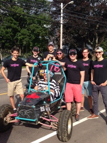 Students with the Baja racer they built.