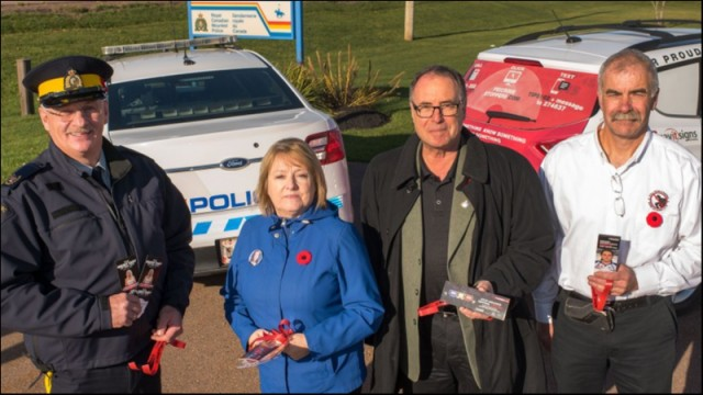 (L-R) S/Sgt Hank Pollard / MADD PEI Trudy Betts / Graham Miner    Director PEI Hwy Safety Division and Scott Lundrigan Prov. Coordinator PEI Crime Stoppers.