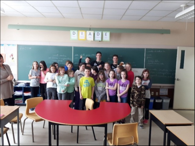 Charlottetown Islander Players Nathaniel Doyon & Cayse Ton with students of Ecole La-Belle-Cloche in Fortune Bridge, PE