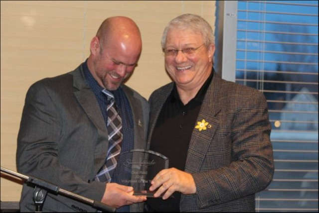 Past President PEICS, Don Reid (L), accepts the City of Summerside Volunteer of the Year Award from City Counsellor Tyler Desroches.