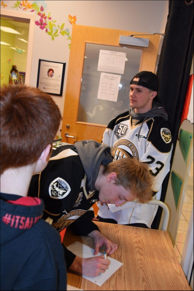 Nov 27 / 2018 Ecole Pierre Chiasson Autographs with Xavier Fortin and Zac Beauregard of this Year's Anti-Bullying talks with Crime Stoppers and the Charlottetown Islanders Hockey Club.
