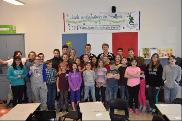 Students of Georgetown Elementary Nov 28th / 2018 with (L-R) Cole Edwards & Will Sirman of the Charlottetown Islanders Hockey Club in support of this Year's Anti-Bullying Campaign.