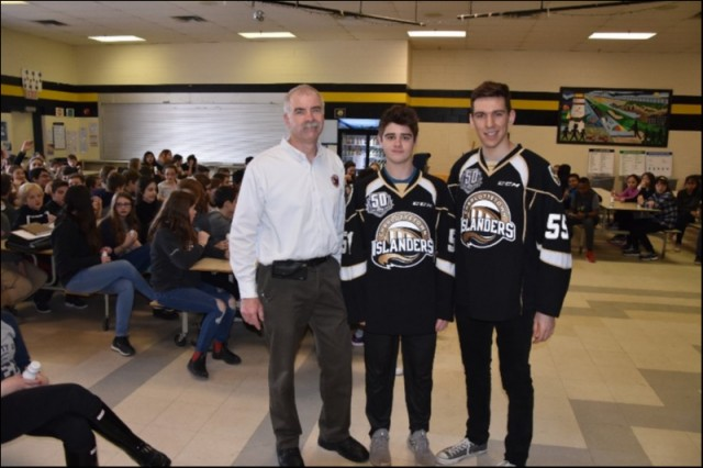 (L-R) Prov. Coordinator Scott Lundrigan, Lukas Cormier and Xavier Bernard of the Charlottetown Islanders at Queen Charlotte Intermediate doing Anti-Bullying presentation to Grade 7s. Jan 29 / 2019.