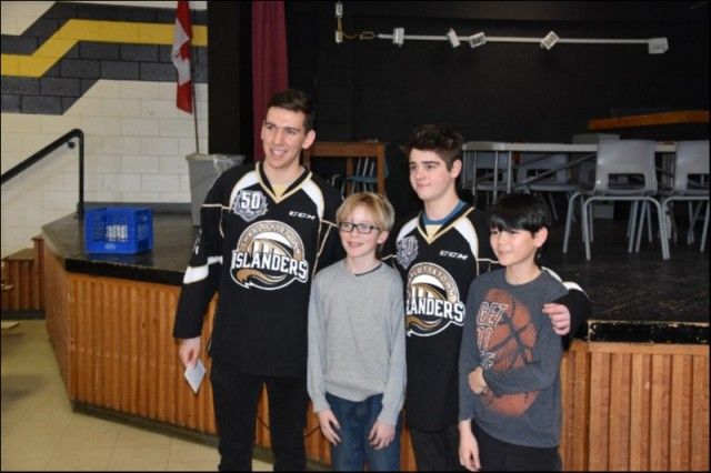 Xavier Bernard and Lukas Cormier with two Grade Seven Students who presented a Thank-You gift to the players for presenting on the topic of Anti Bullying.  Queen Charlotte Intermediate 29 Jan 2019.