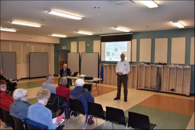 (L-R) RCMP Chief Superintendent (ret.) Randy Robar and Provincial Coordinator Scott Lundrigan doing a Fraud Proofing presentation to approximately 40 Seniors at the Cornwall Recreation Center.  Jan 29 / 2019