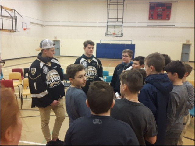 (L-R)  Isaak Pelletier and Liam Peyton of the Charlottetown Islanders Hockey Club with Montague Intermediate Grade 7 students after Anti-Bullying Presentation on 11 Feb 2019.   Several aspiring NHL prospects pump the pair for advice on how to get where they are. Although a young group, they were well versed in the sport and what they needed to do to get ahead.