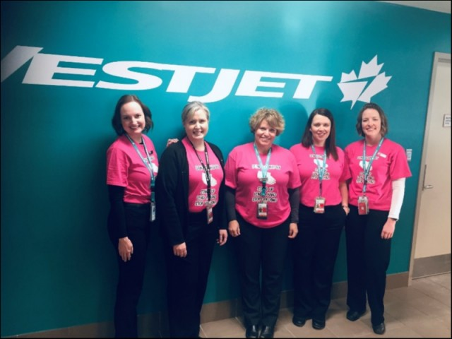 The employees of Westjet show off their Pink Pride on the 27th of February at the Charlottetown Airport. Thank-You ladies for your support of this worth while project!