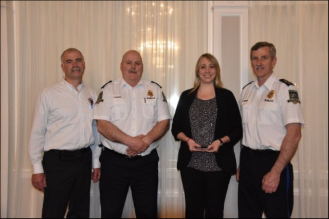 (L/R) Prov. Coordinator PEI Crime Stoppers, Scott Lundrigan, Chief David Poirier of the Summerside Police Service, Cpl Jennifer Driscoll of the Summerside Police Service and winner of the Municipal Police Officer of the Year and Deputy Chief of the Summerside Police Service, Sinclair Walker.