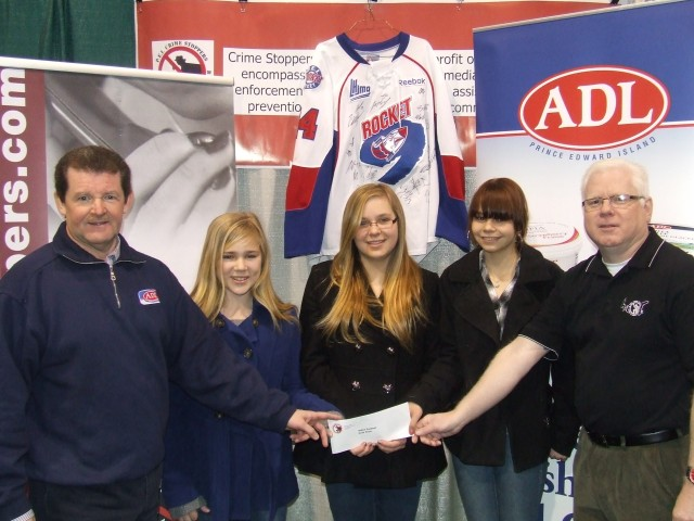 1st. Place winners from East Wiltshire Intermediate School receive their prize of $500 from ADL Advertising and Marketing Manager David Doherty and PEI Crime Stoppers President Gary Bowness. (L to R: David Doherty.Corrin Doucette, Katelyn Ford, Cynthia Young and Gary Bownees)
