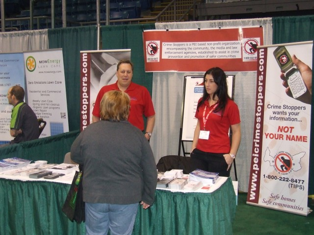 Scott and Jaime talk to a visitor about our program.