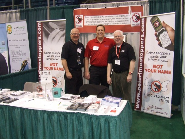 Coordinator Phil Pitts, Scott and Gary at our booth.