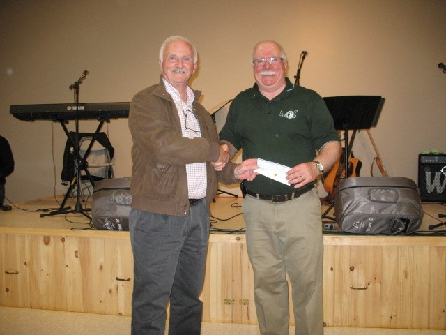 David Linkletter, Linkletter Community Hall,  makes donation to Phil Pitts, PEI Crime Stopeprs Coordinator