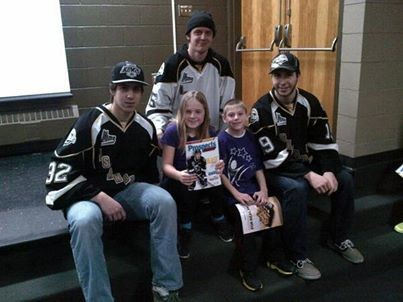 Players Eric Brassard, Guyome Rioux-Legault and Alexandre Goulet with students.