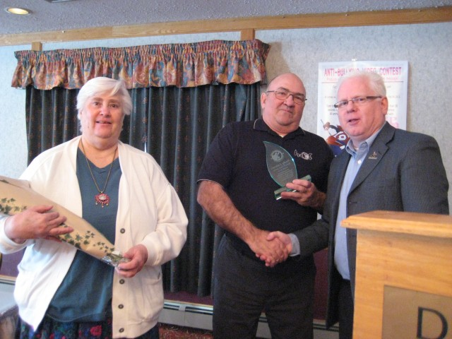 Pres. Gary Bowness(R)presents awards to Andy(C) and Terri(R) LaBonte