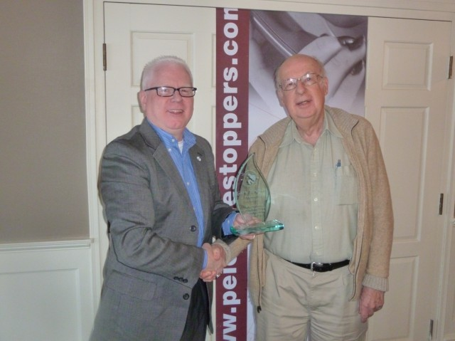 L to R: Outgoing President receives appreciation award from Vice-President Norbert Stewart