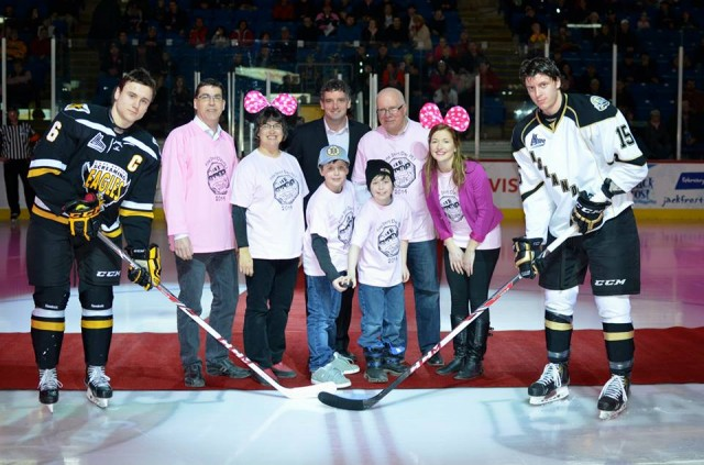 Islander Player, Guyome Rioux-Legault with students, Pink Shirt Chairperson Joe Killorn and Phil Pitts, Coordinator PEI Crime Stoppers.