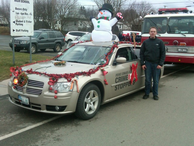Director Jason Hughes has the car looking good and ready to roll in the 2011 Souris Christmas Parade