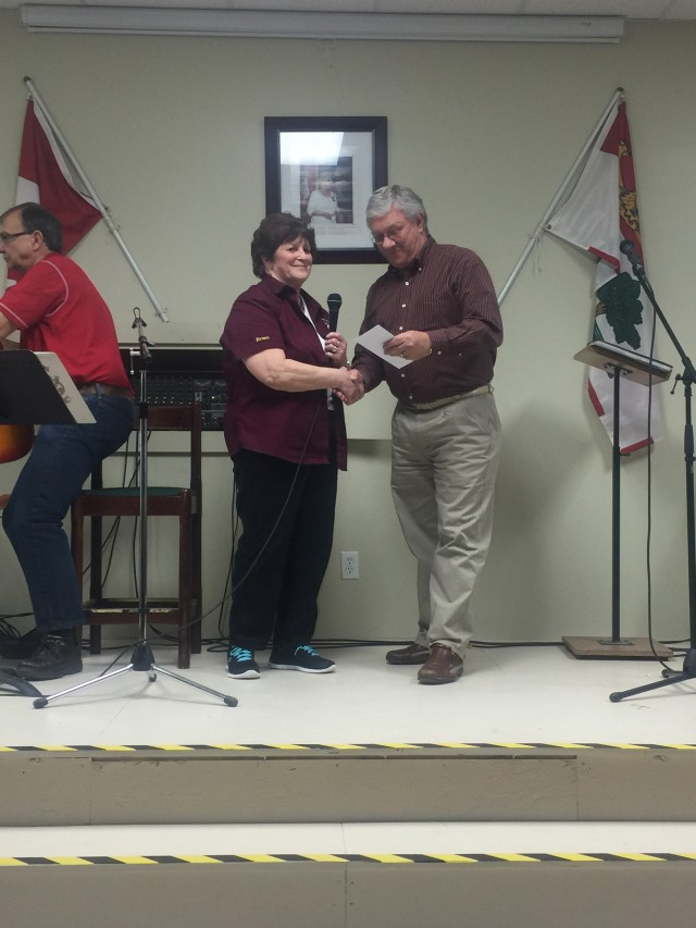 Cathy from the Stratford Lions Club presents Crime Stoppers President Don with donation.