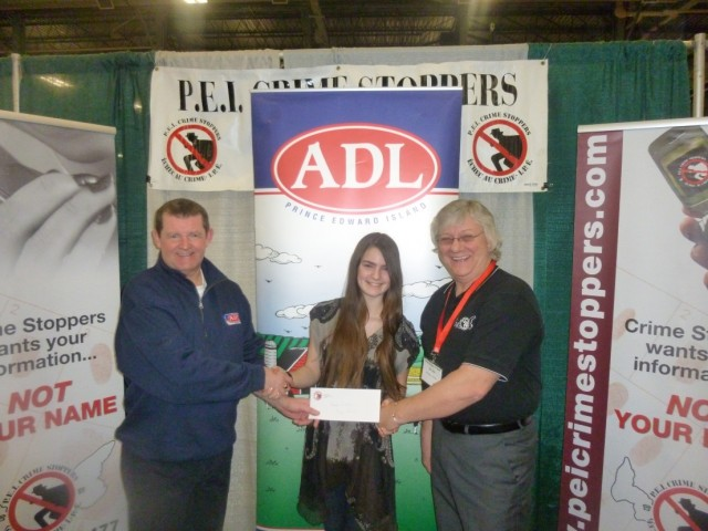 ADL Advertising and Marketing Manager: David Doherty(L) and PEI Crimestoppers President Don Reid(R) present 1st place prize to Sarah Blaisdell.