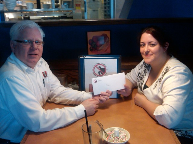 PEI Crime Stoppers President Gary Bowness makes a presentation to Amy